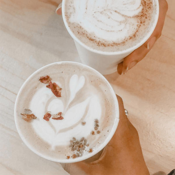 White poly cups filled with latte coffee