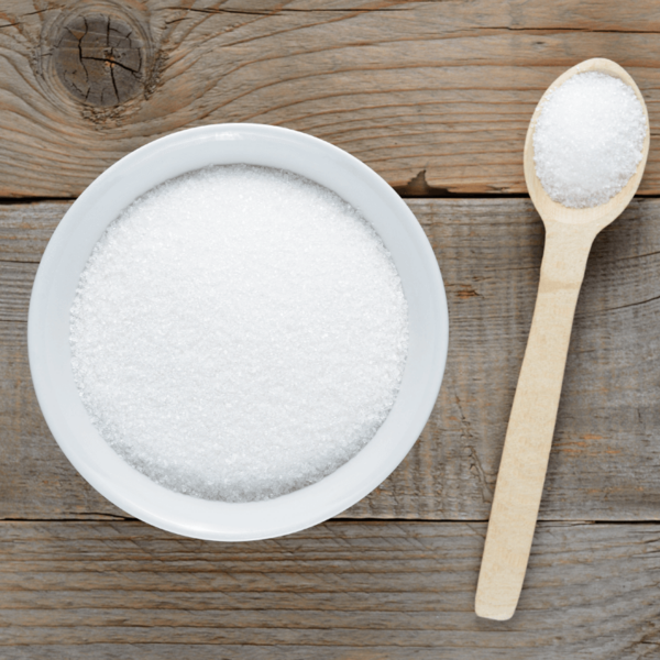 Bowl of sweetener with wooden spoon