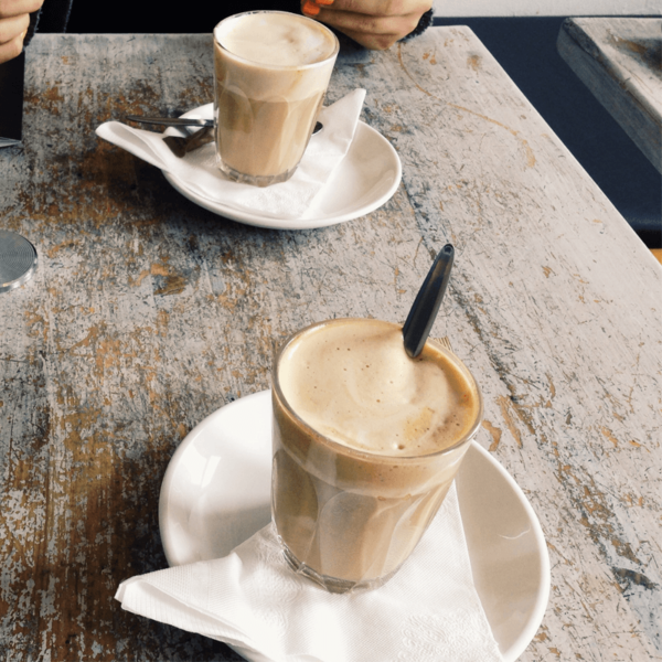 White paper napkin under a latte cup