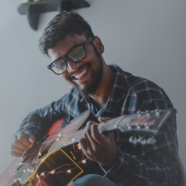 Happy man playing guitar