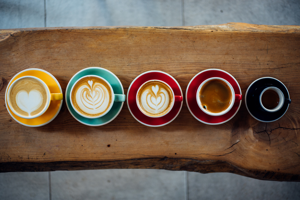 five different cups of coffee lined up in a row